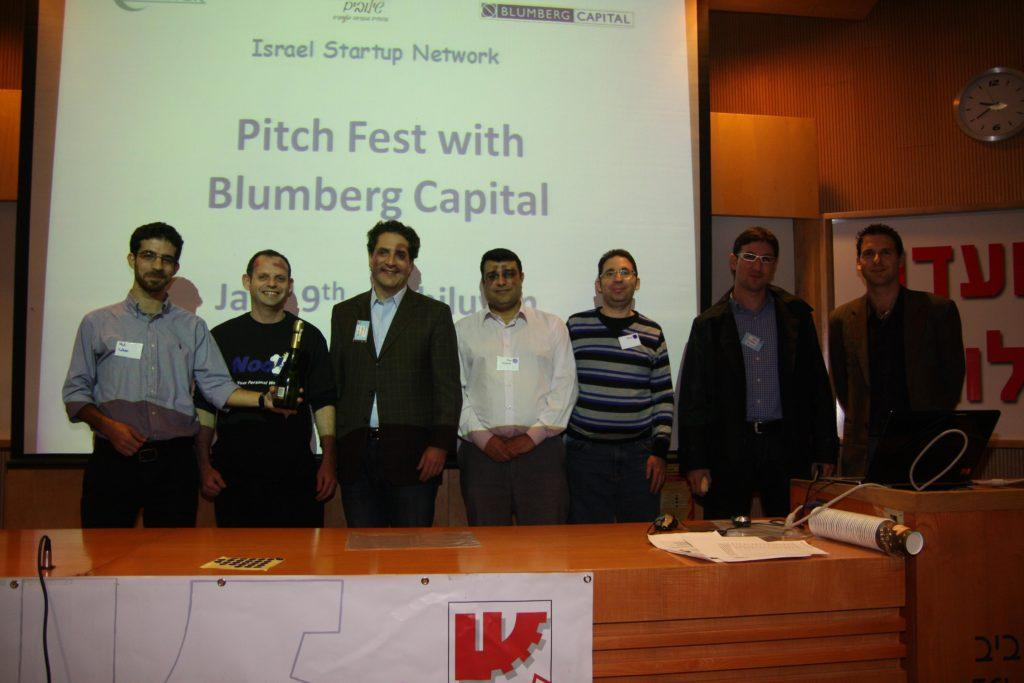 Moti Cohen, CEO @ Qmerce, Winning 1st Place, next to: Yaron Reich, CEO of Nooly; Bruce Taragin and Alon Lifshitz from Blumberg Capital and Haggai Yedidya