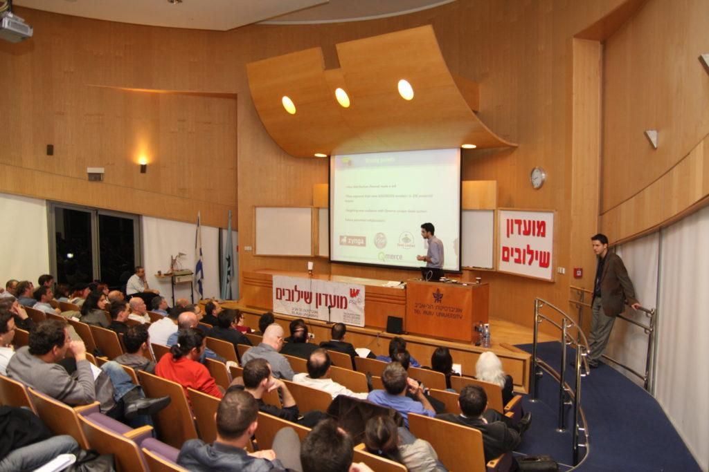 Moti Cohen, previously CEO of Qmerce, presenting live at the finals of the startup competition @ Tel Aviv University. On the right: Haggai Yedidya
